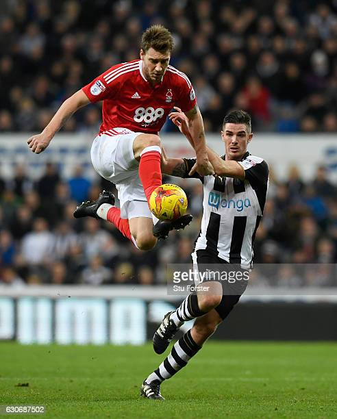 Nicklas Bendtner challenges Ciaran Clark of Newcastle during the Sky Bet Championship match between Newcastle United and Nottingham Forest at St...