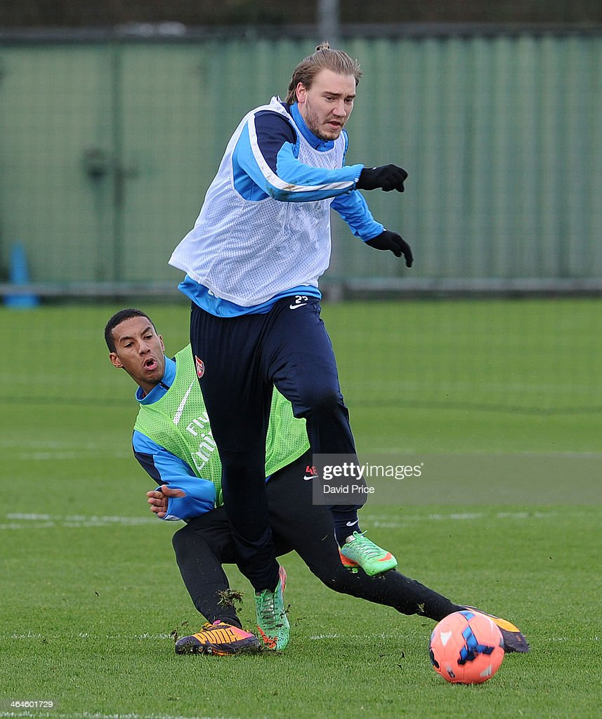Nicklas Bendtner is challenged by Isaac Hayden of Arsenal during Arsenal Training Session at London Colney on January 23, 2014 in St Albans, England.