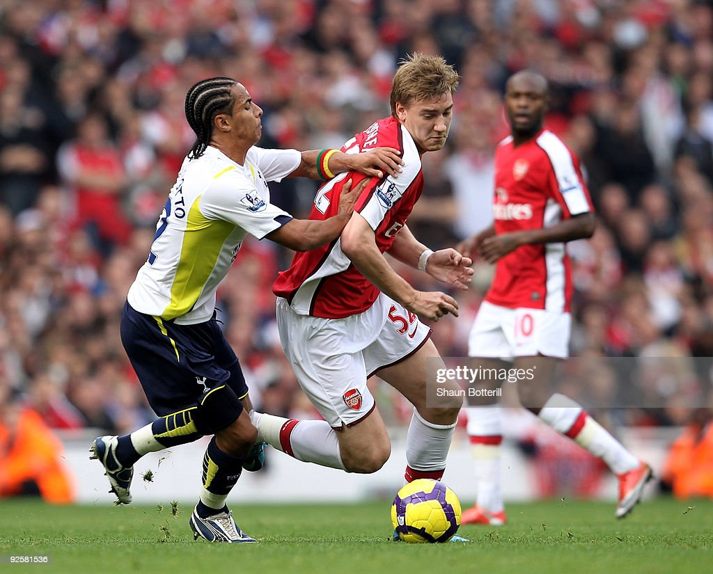 <a gi-track='captionPersonalityLinkClicked' href=/galleries/search?phrase=Nicklas+Bendtner&family=editorial&specificpeople=2142069 ng-click='$event.stopPropagation()'>Nicklas Bendtner</a> of Arsenal is challenged by <a gi-track='captionPersonalityLinkClicked' href=/galleries/search?phrase=Benoit+Assou-Ekotto&family=editorial&specificpeople=709848 ng-click='$event.stopPropagation()'>Benoit Assou-Ekotto</a> of Tottenham Hotspur during the Barclays Premier League match between Arsenal and Tottenham Hotspur at the Emirates Stadium on October 31, 2009 in London, England.