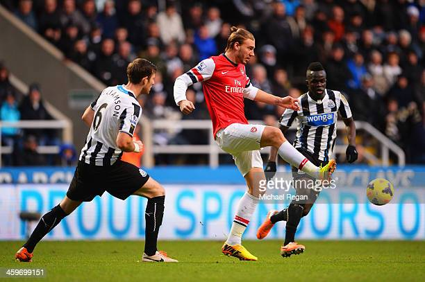 Nicklas Bendtner of Arsenal is closed down by Michael Williamson and Cheick Tiote of Newcastle United during the Barclays Premier League match...