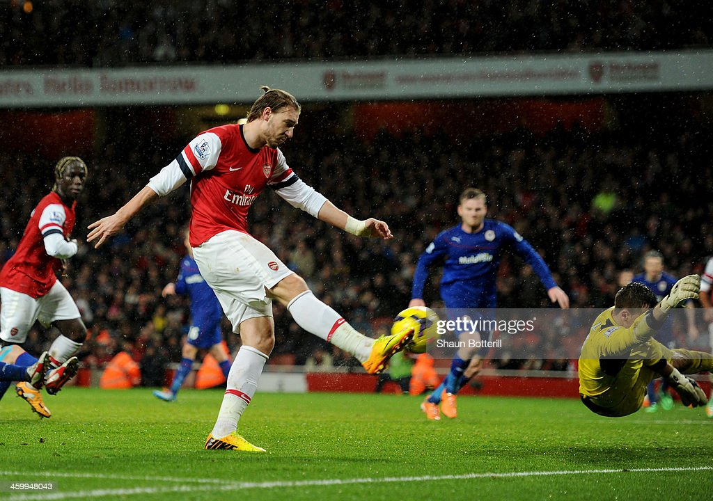 <a gi-track='captionPersonalityLinkClicked' href=/galleries/search?phrase=Nicklas+Bendtner&family=editorial&specificpeople=2142069 ng-click='$event.stopPropagation()'>Nicklas Bendtner</a> of Arsenal scores their first goal during the Barclays Premier League match between Arsenal and Cardiff City at Emirates Stadium on January 1, 2014 in London, England.
