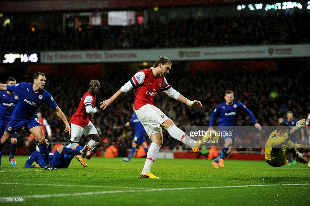 Nicklas Bendtner of Arsenal scores their first goal during the Barclays Premier League match between Arsenal and Cardiff City at Emirates Stadium on...