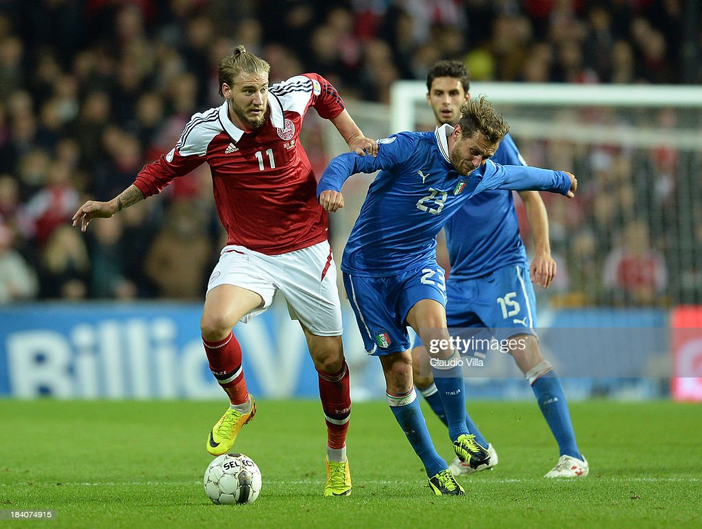 <a gi-track='captionPersonalityLinkClicked' href=/galleries/search?phrase=Nicklas+Bendtner&family=editorial&specificpeople=2142069 ng-click='$event.stopPropagation()'>Nicklas Bendtner</a> of Denmark and <a gi-track='captionPersonalityLinkClicked' href=/galleries/search?phrase=Alessandro+Diamanti&family=editorial&specificpeople=4891338 ng-click='$event.stopPropagation()'>Alessandro Diamanti</a> of Italy #23 compete for the ball during the FIFA 2014 World Cup Qualifying group B match between Denmark and Italy at Parken Stadium on October 11, 2013 in Copenhagen, Denmark.
