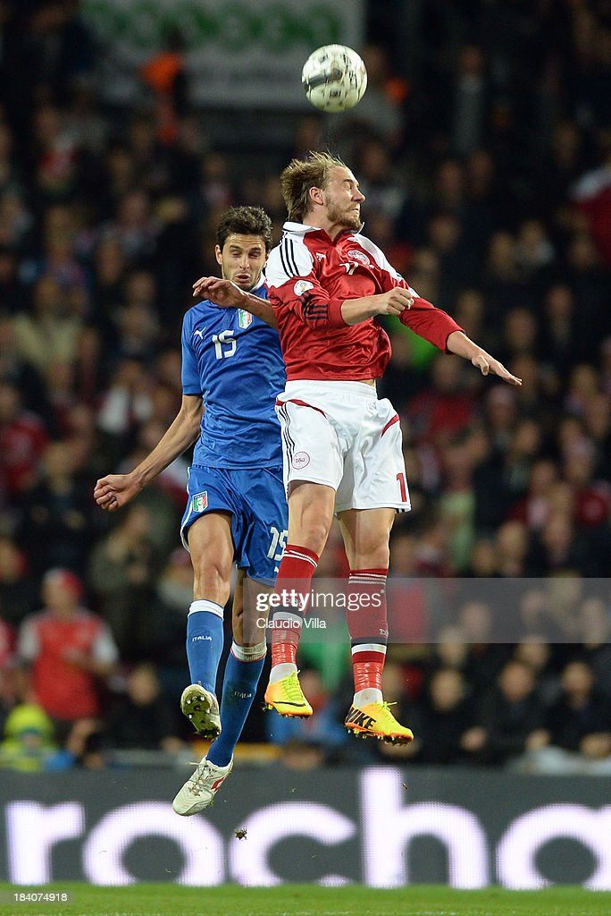 <a gi-track='captionPersonalityLinkClicked' href=/galleries/search?phrase=Nicklas+Bendtner&family=editorial&specificpeople=2142069 ng-click='$event.stopPropagation()'>Nicklas Bendtner</a> of Denmark and <a gi-track='captionPersonalityLinkClicked' href=/galleries/search?phrase=Andrea+Ranocchia&family=editorial&specificpeople=4085825 ng-click='$event.stopPropagation()'>Andrea Ranocchia</a> of Italy #15 compete for the ball during the FIFA 2014 World Cup Qualifying group B match between Denmark and Italy at Parken Stadium on October 11, 2013 in Copenhagen, Denmark.