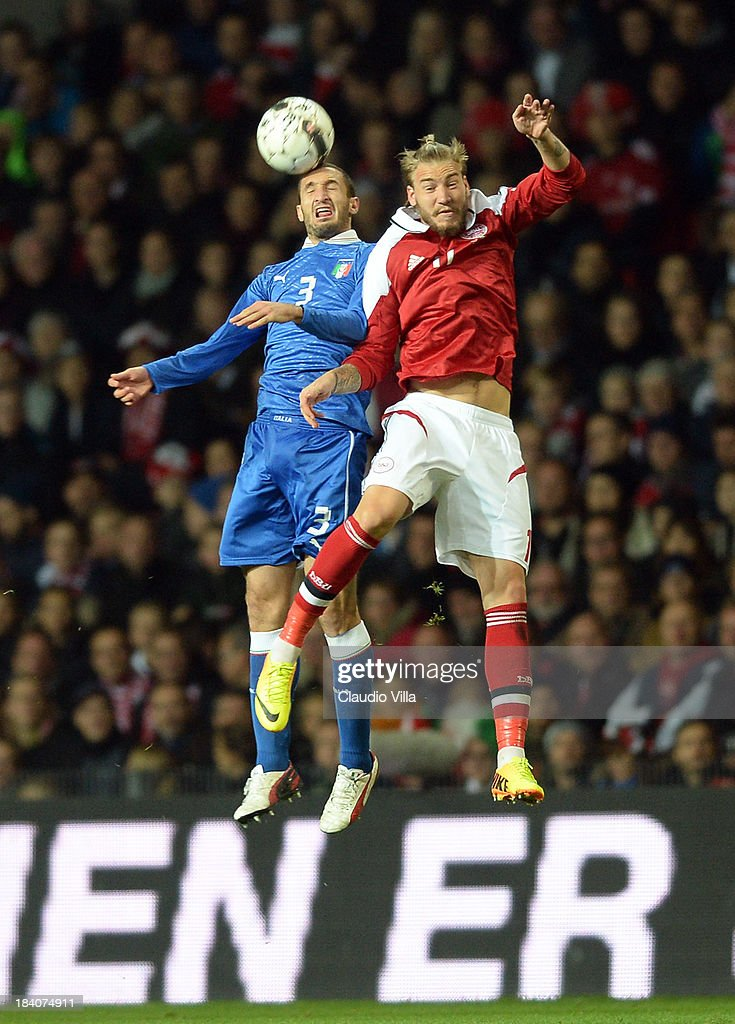 <a gi-track='captionPersonalityLinkClicked' href=/galleries/search?phrase=Nicklas+Bendtner&family=editorial&specificpeople=2142069 ng-click='$event.stopPropagation()'>Nicklas Bendtner</a> of Denmark and <a gi-track='captionPersonalityLinkClicked' href=/galleries/search?phrase=Giorgio+Chiellini&family=editorial&specificpeople=605793 ng-click='$event.stopPropagation()'>Giorgio Chiellini</a> of Italy #3 compete for the ball during the FIFA 2014 World Cup Qualifying group B match between Denmark and Italy at Parken Stadium on October 11, 2013 in Copenhagen, Denmark.