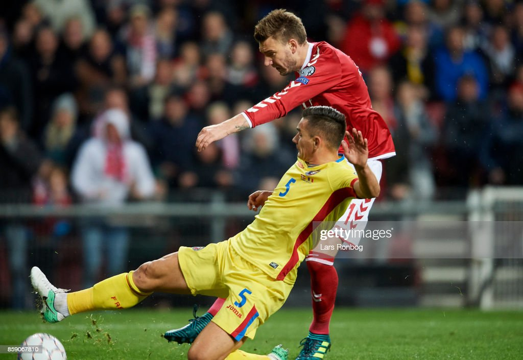 Nicklas Bendtner of Denmark and Ovidiu Hoban of Romania compete for the ball during the FIFA World Cup 2018 qualifier match between Denmark and Romania at Telia Parken Stadium on October 8, 2017 in Copenhagen, Denmark.