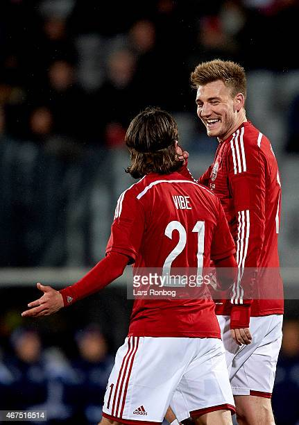 Nicklas Bendtner of Denmark and team mate Lasse Vibe celebrate after scoring their first goal during the International Friendly match between Denmark...