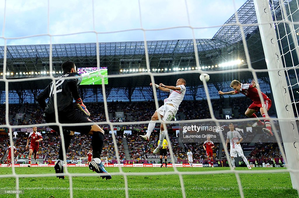 L'VIV UKRAINE JUNE 13 Nicklas Bendtner of Denmark beats Pepe of Portugal to head in their second goal during the UEFA EURO 2012 group B match between...