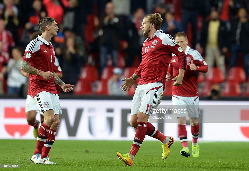Nicklas Bendtner of Denmark celebrates after scoring his team's first goal to equalise during the FIFA 2014 World Cup qualifier between Denmark and...