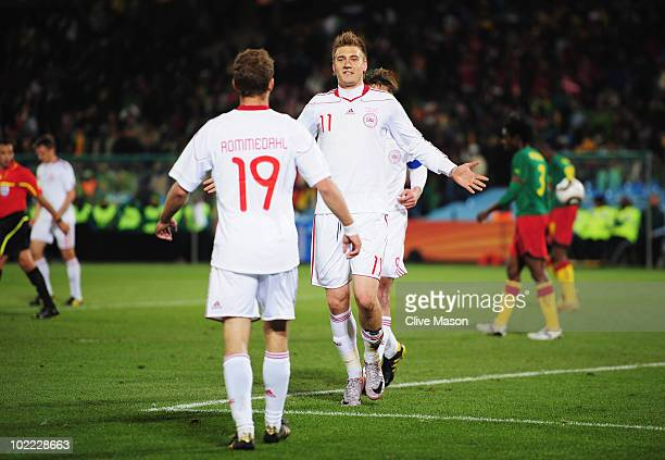Nicklas Bendtner of Denmark celebrates scoring his team's first goal with team mate Dennis Rommedahl during the 2010 FIFA World Cup South Africa...