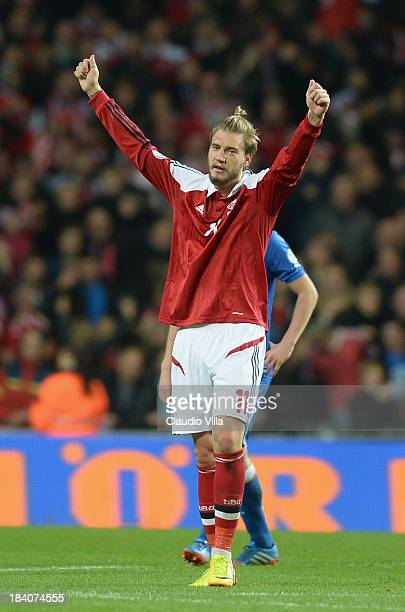 Nicklas Bendtner of Denmark celebrates scoring their second goal during the FIFA 2014 world cup qualifier between Denmark and Italy on October 11...