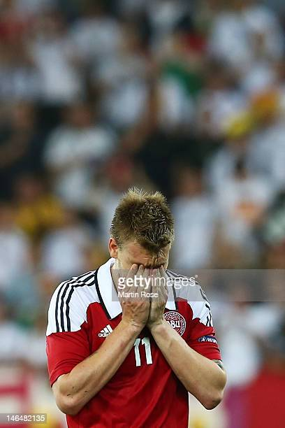 L'VIV UKRAINE JUNE 17 Nicklas Bendtner of Denmark puts his head in his hands after the UEFA EURO 2012 group B match between Denmark and Germany at...