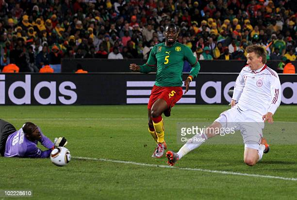Nicklas Bendtner of Denmark scores past Hamidou Souleymanou of Cameroon during the 2010 FIFA World Cup South Africa Group E match between Cameroon...