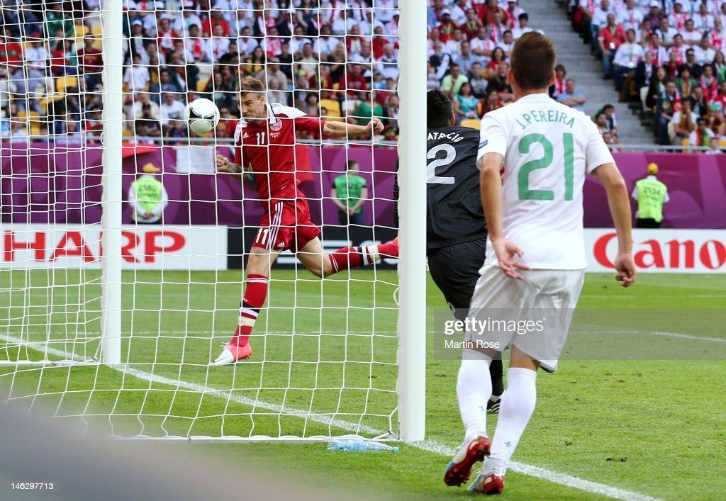 L'VIV UKRAINE JUNE 13 Nicklas Bendtner of Denmark scores their first goal during the UEFA EURO 2012 group B match between Denmark and Portugal at...