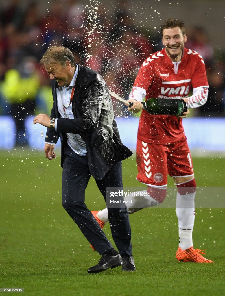 Nicklas Bendtner of Denmark sprays Aage Hareide, Manager of Denmark with champagne after the FIFA 2018 World Cup Qualifier Play-Off: Second Leg between Republic of Ireland and Denmark at Aviva Stadium on November 14, 2017 in Dublin, Ireland.
