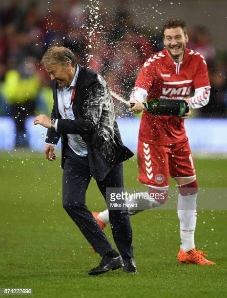 Nicklas Bendtner of Denmark sprays Aage Hareide Manager of Denmark with champagne after the FIFA 2018 World Cup Qualifier PlayOff Second Leg between...
