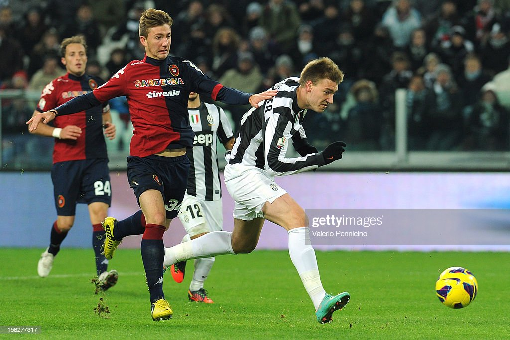 Nicklas Bendtner (R) of Juventus FC is challenged by Dario Del Fabro of Cagliari Calcio during the TIM Cup match between Juventus FC and Cagliari Calcio at Juventus Arena on December 12, 2012 in Turin, Italy.