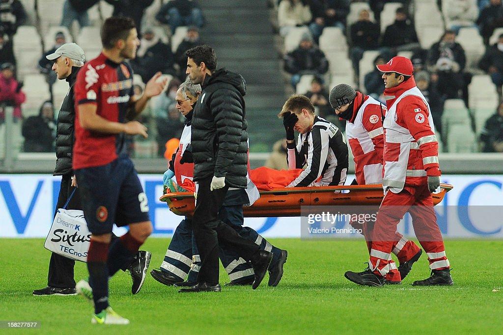 Nicklas Bendtner of Juventus FC lies injured during the TIM Cup match between Juventus FC and Cagliari Calcio at Juventus Arena on December 12, 2012 in Turin, Italy.