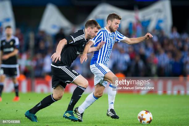 Nicklas Bendtner of Rosenborg BK duels for the ball with Asier Illarramendi of Real Sociedad during the UEFA Europa League group L match between Real...