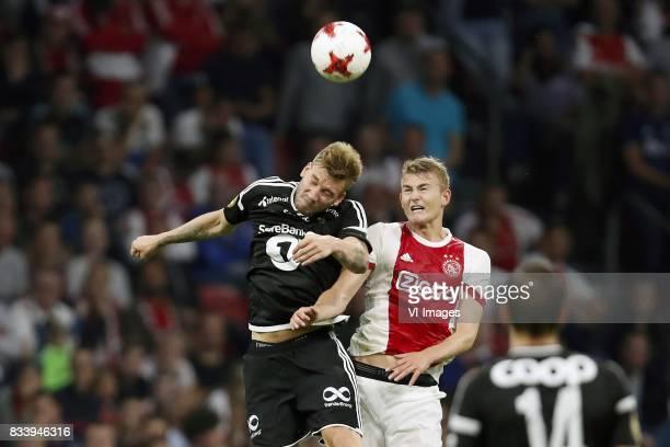Nicklas Bendtner of Rosenborg BK Matthijs de Ligt of Ajax during the UEFA Europa League fourth round qualifying first leg match between Ajax...