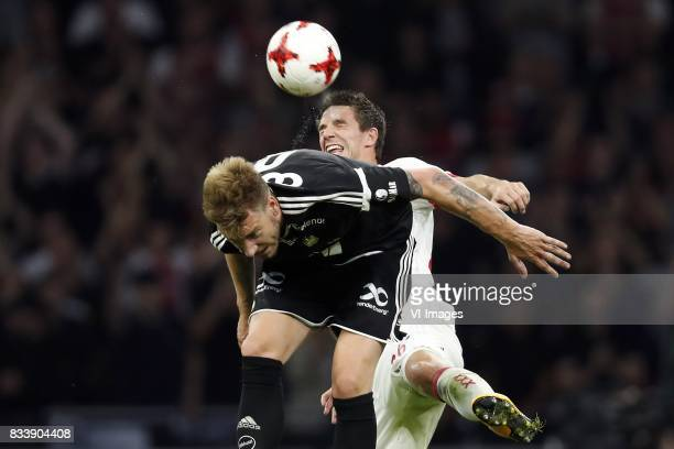 Nicklas Bendtner of Rosenborg BK Nick Viergever of Ajax during the UEFA Europa League fourth round qualifying first leg match between Ajax Amsterdam...