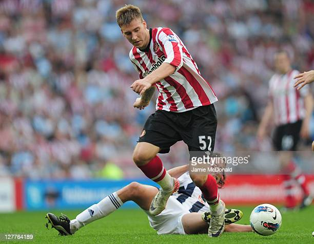 Nicklas Bendtner of Sunderland battles with Jonas Olsson of West Bromwich Albion during the Barclays Premier League match between Sunderland and West...