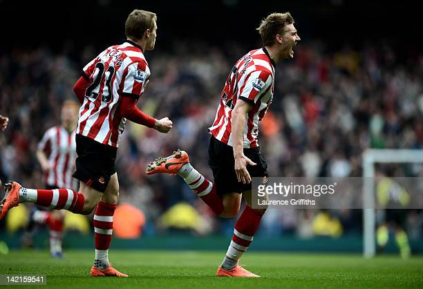 Nicklas Bendtner of Sunderland celebrates scoring his team's second goal during the Barclays Premier League match between Manchester City and...