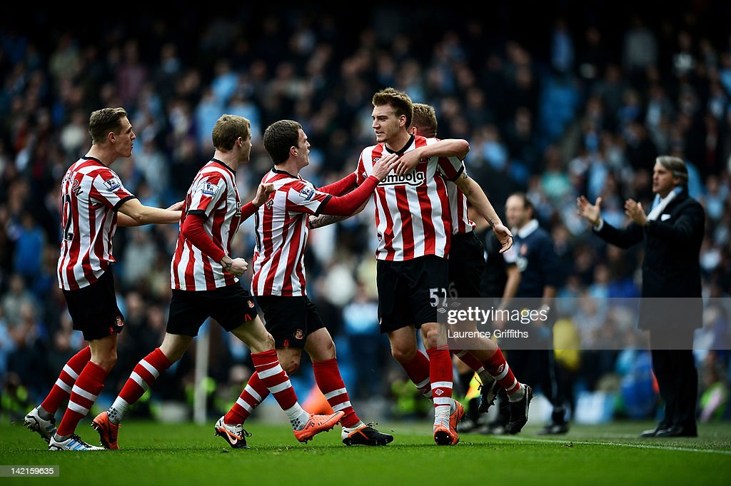 Nicklas Bendtner of Sunderland celebrates with his team mates after scoring his team's second goal during the Barclays Premier League match between...