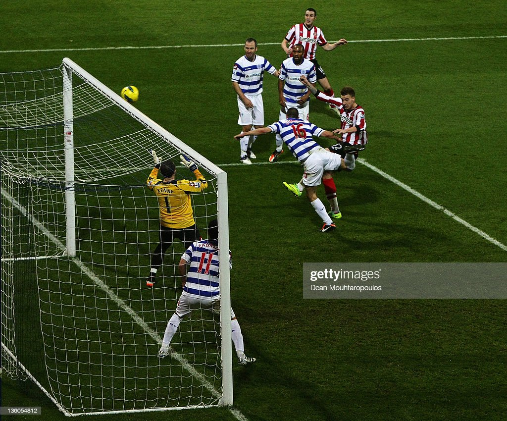 Nicklas Bendtner of Sunderland heads and scores the first goal of the game during the Barclays Premier League match between Queens Park Rangers and...