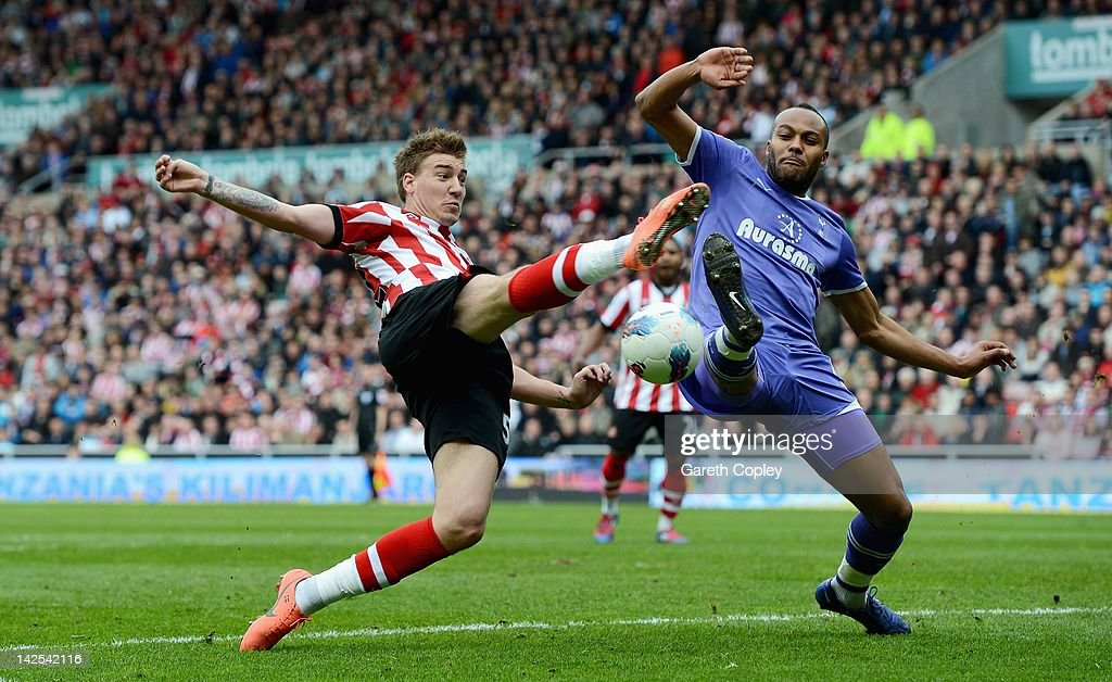 <a gi-track='captionPersonalityLinkClicked' href=/galleries/search?phrase=Nicklas+Bendtner&family=editorial&specificpeople=2142069 ng-click='$event.stopPropagation()'>Nicklas Bendtner</a> of Sunderland is challenged by <a gi-track='captionPersonalityLinkClicked' href=/galleries/search?phrase=Younes+Kaboul&family=editorial&specificpeople=685970 ng-click='$event.stopPropagation()'>Younes Kaboul</a> (R) of Tottenham during the Barclays Premier League match between Sunderland and Tottenham Hotspur at the Stadium of Light on April 7, 2012 in Sunderland, England.