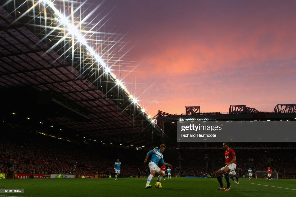 Nicklas Bendtner of Sunderland is held off by Rio Ferdinand of Man Utd during the Barclays Premier League match between Manchester United and...