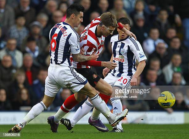 Nicklas Bendtner of Sunderland is tackled by Liam Ridgwell of West Bromwich Albion during the Barclays Premier League match between West Bromwich...