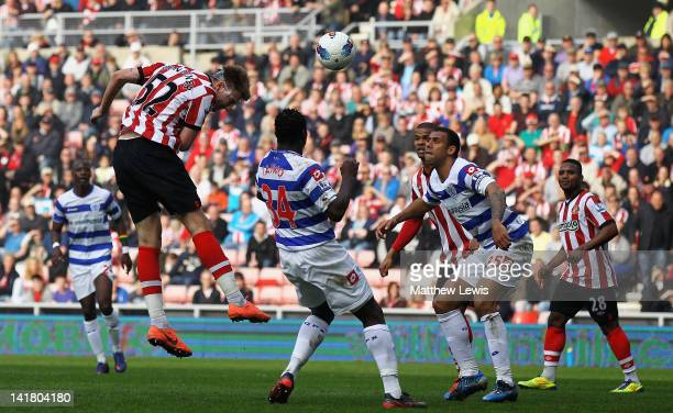 Nicklas Bendtner of Sunderland scores a goal from a header during the Barclays Premier League match between Sunderland and Queens Park Rangers at...