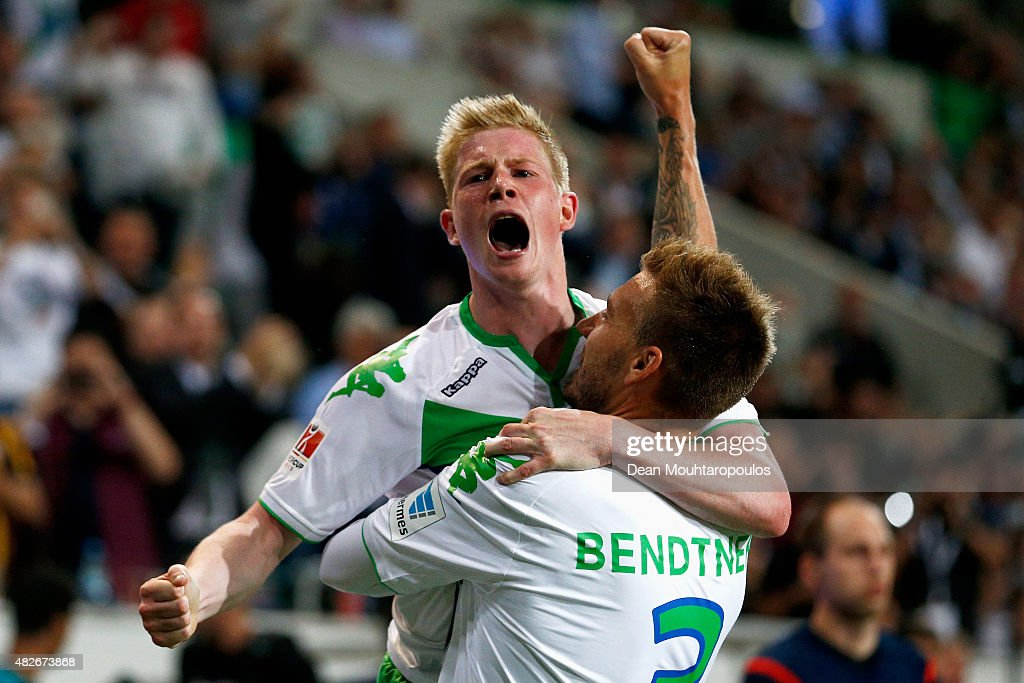 Nicklas Bendtner of VfL Wolfsburg celebrates scoring his teams first goal of the game with team mate Kevin De Bruyne during the DFL Supercup match between VfL Wolfsburg and FC Bayern Muenchen at Volkswagen Arena on August 1, 2015 in Wolfsburg, Germany.
