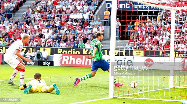 Nicklas Bendtner of Wolfsburg scores the 11 goal against Goalkeeper Timo Horn of Cologne during the Bundesliga match between 1 FC Koeln and VfL...