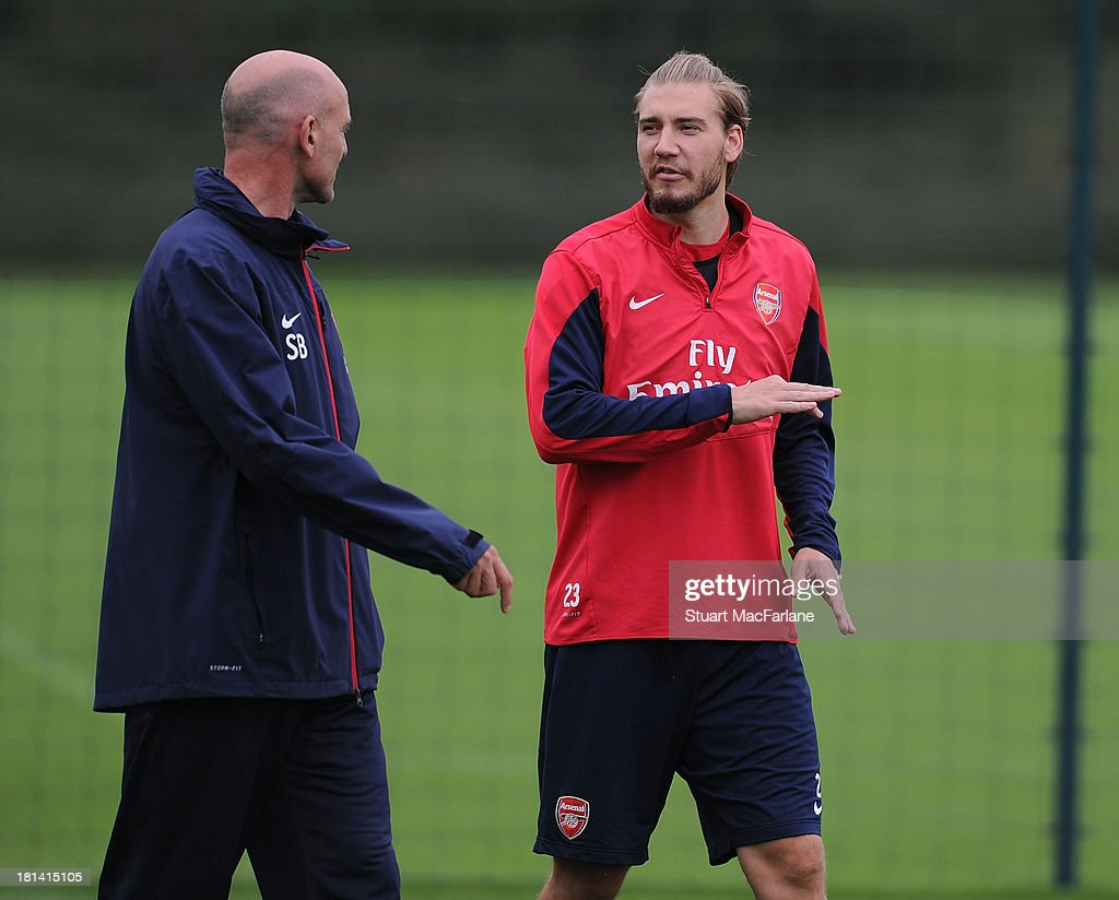 <a gi-track='captionPersonalityLinkClicked' href=/galleries/search?phrase=Nicklas+Bendtner&family=editorial&specificpeople=2142069 ng-click='$event.stopPropagation()'>Nicklas Bendtner</a> with Arsenal assistant manager Steve Bould before a training session at London Colney on September 21, 2013 in St Albans, England.