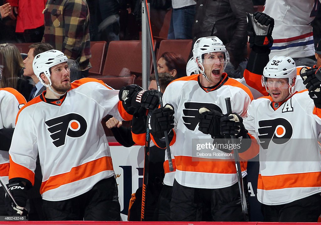 Nicklas Grossmann Braydon Coburn and Mark Streit of the Philadelphia Flyers show emotion during the game against the Anaheim Ducks on December 3 2014...