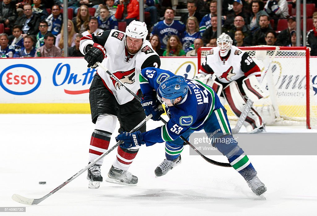 Nicklas Grossmann #2 of the Arizona Coyotes checks Bo Horvat #53 of the Vancouver Canucks during their NHL game at Rogers Arena March 9, 2016 in Vancouver, British Columbia, Canada. Vancouver won 3-2 in overtime.