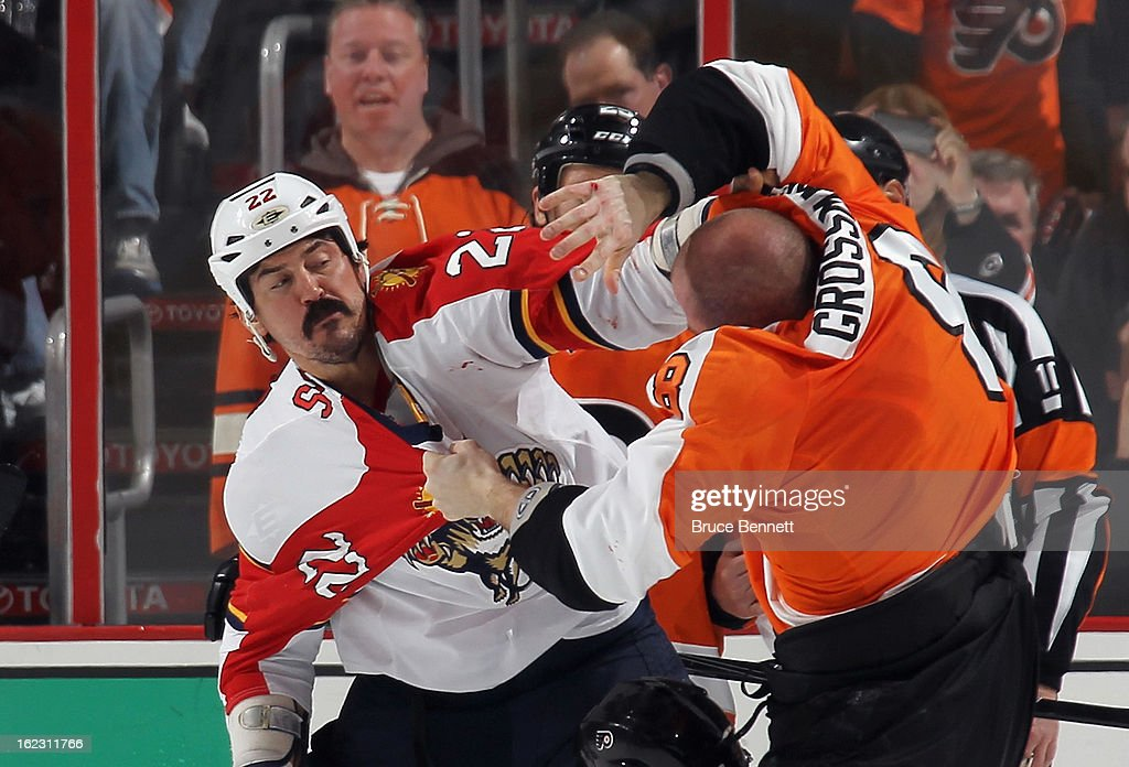 Nicklas Grossmann #8 of the Philadelphia Flyers and George Parros #22 of the Florida Panthers fight during the second period at the Wells Fargo Center on February 21, 2013 in Philadelphia, Pennsylvania.