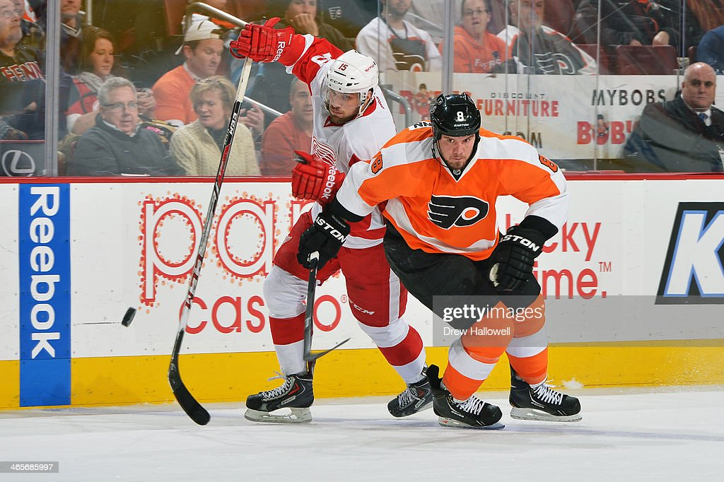 <a gi-track='captionPersonalityLinkClicked' href=/galleries/search?phrase=Nicklas+Grossman&family=editorial&specificpeople=2284863 ng-click='$event.stopPropagation()'>Nicklas Grossman</a>n #8 of the Philadelphia Flyers and <a gi-track='captionPersonalityLinkClicked' href=/galleries/search?phrase=Riley+Sheahan&family=editorial&specificpeople=7029365 ng-click='$event.stopPropagation()'>Riley Sheahan</a> #15 of the Detroit Red Wings race for the puck at the Wells Fargo Center on January 28, 2014 in Philadelphia, Pennsylvania. The Flyers won 5-0.
