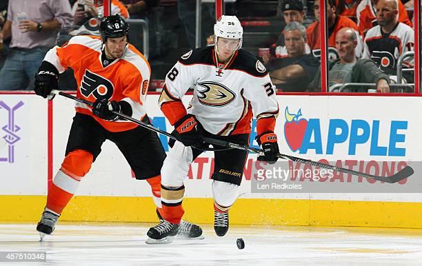 Nicklas Grossmann of the Philadelphia Flyers battles William Karlsson of the Anaheim Ducks for the puck on October 14 2014 at the Wells Fargo Center...