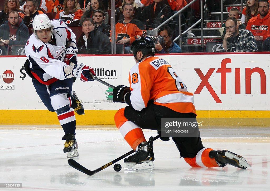 Nicklas Grossmann #8 of the Philadelphia Flyers blocks a shot by Alex Ovechkin #8 of the Washington Capitals on February 27, 2013 at the Wells Fargo Center in Philadelphia, Pennsylvania.