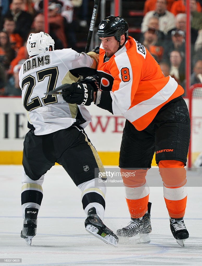 <a gi-track='captionPersonalityLinkClicked' href=/galleries/search?phrase=Nicklas+Grossman&family=editorial&specificpeople=2284863 ng-click='$event.stopPropagation()'>Nicklas Grossman</a>n #8 of the Philadelphia Flyers checks <a gi-track='captionPersonalityLinkClicked' href=/galleries/search?phrase=Craig+Adams&family=editorial&specificpeople=211144 ng-click='$event.stopPropagation()'>Craig Adams</a> #27 of the Pittsburgh Penguins at the Wells Fargo Center on March 7, 2013 in Philadelphia, Pennsylvania. The Penguins won 5-4.