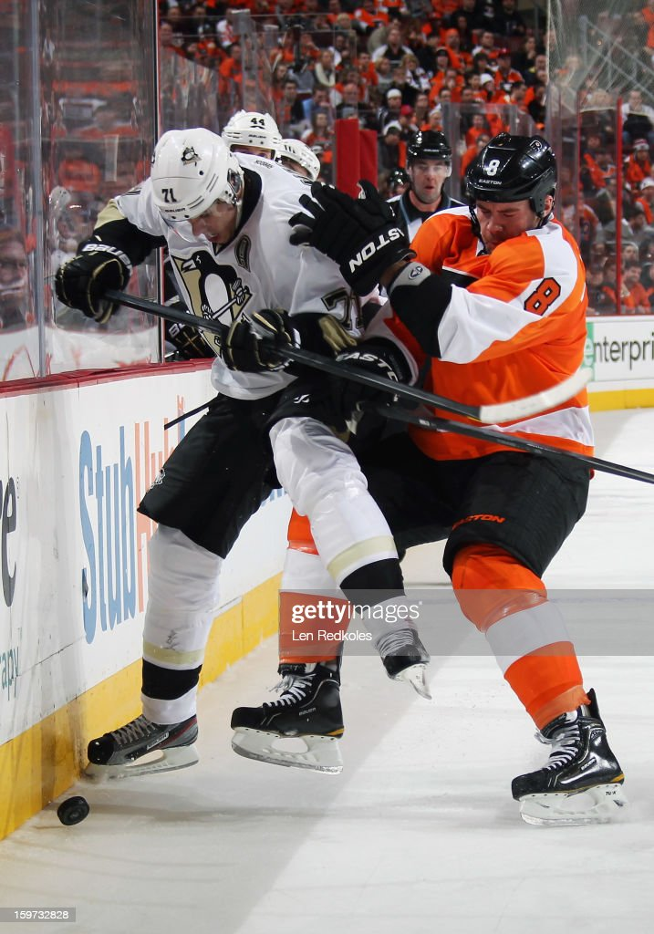 Nicklas Grossmann #8 of the Philadelphia Flyers checks Evgeni Malkin #71 of the Pittsburgh Penguins into the boards on January 19, 2013 at the Wells Fargo Center in Philadelphia, Pennsylvania. The Penguins went on to defeat the Flyers 3-1.