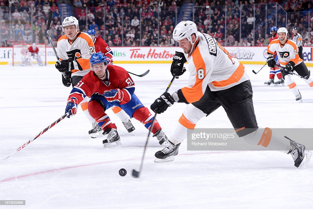 <a gi-track='captionPersonalityLinkClicked' href=/galleries/search?phrase=Nicklas+Grossman&family=editorial&specificpeople=2284863 ng-click='$event.stopPropagation()'>Nicklas Grossman</a>n #8 of the Philadelphia Flyers clears the puck in front of <a gi-track='captionPersonalityLinkClicked' href=/galleries/search?phrase=David+Desharnais&family=editorial&specificpeople=4084305 ng-click='$event.stopPropagation()'>David Desharnais</a> #51 of the Montreal Canadiens during the NHL game at the Bell Centre on February 16, 2013 in Montreal, Quebec, Canada. The Canadiens defeated the Flyers 4-1.