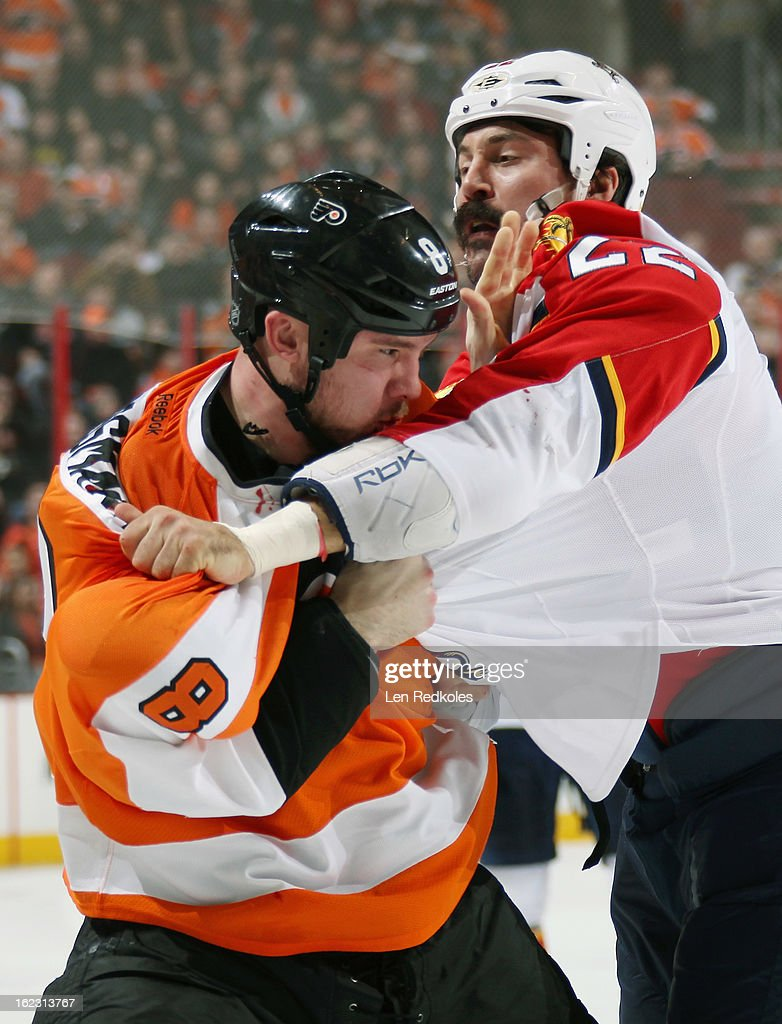 Nicklas Grossmann #8 of the Philadelphia Flyers fights George Parros #22 of the Florida Panthers in the second period on February 21, 2013 at the Wells Fargo Center in Philadelphia, Pennsylvania.