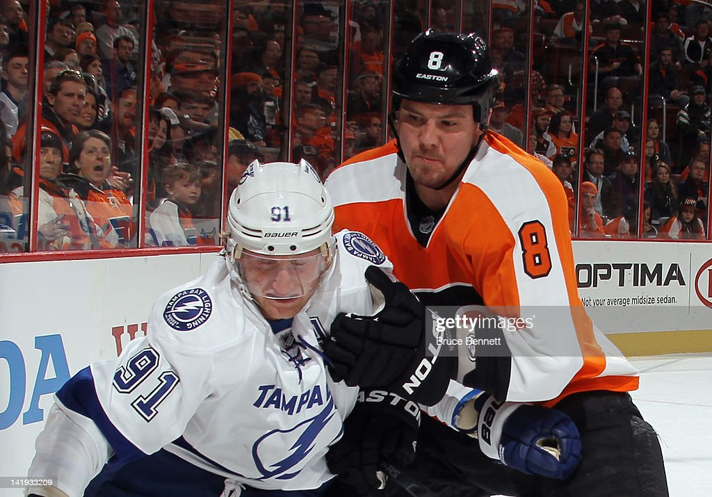 Nicklas Grossmann of the Philadelphia Flyers hangs on to Steven Stamkos of the Tampa Bay Lightning at the Wells Fargo Center on March 26 2012 in...