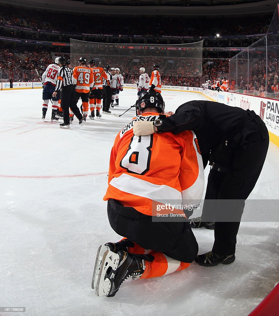 Nicklas Grossmann of the Philadelphia Flyers is attended to following a first period check by Tom Wilson of the Washington Capitals at the Wells...