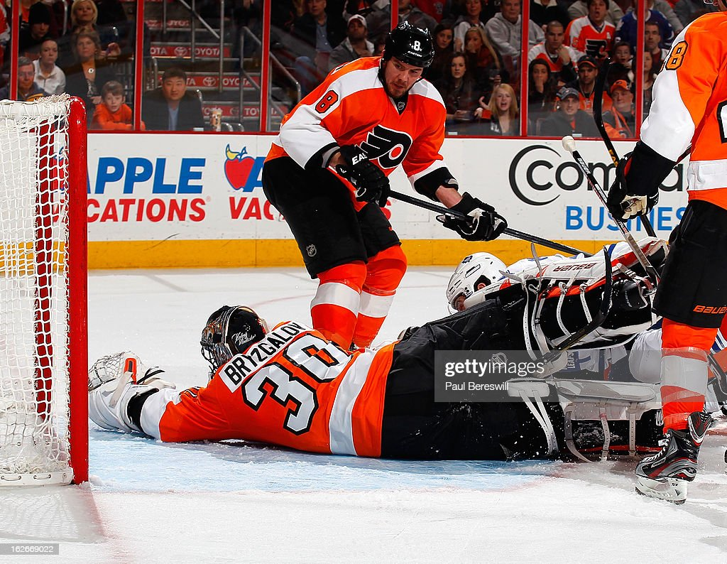 <a gi-track='captionPersonalityLinkClicked' href=/galleries/search?phrase=Nicklas+Grossman&family=editorial&specificpeople=2284863 ng-click='$event.stopPropagation()'>Nicklas Grossman</a>n #8 of the Philadelphia Flyers looks down as Flyers goalie <a gi-track='captionPersonalityLinkClicked' href=/galleries/search?phrase=Ilya+Bryzgalov&family=editorial&specificpeople=2285430 ng-click='$event.stopPropagation()'>Ilya Bryzgalov</a> #30 cannot stop a shot by <a gi-track='captionPersonalityLinkClicked' href=/galleries/search?phrase=Mikhail+Grabovski&family=editorial&specificpeople=2560547 ng-click='$event.stopPropagation()'>Mikhail Grabovski</a> #84 of the Toronto Maple Leafs, who is hidden by Bryzgalov's pads, in the third period of an NHL Hockey game at Wells Fargo Center on February 25, 2013 in Philadelphia, Pennsylvania.