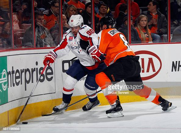 Nicklas Grossmann of the Philadelphia Flyers rides Marcus Johansson of the Washington Capitals into the boards during the first period at the Wells...